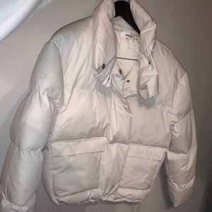 White winter jacket , never worn (too small)